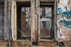 Abandoned building facade. Left abandoned building facade - with graffity Royalty Free Stock Images