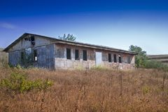 Abandoned building in a hilly area Stock Photo