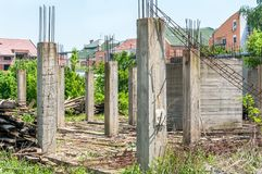 Abandoned building or house unfinished construction site with architectural details of concrete skeleton and reinforcement poles a. Nd iron or steel bars stock photos