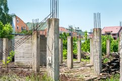 Abandoned building or house unfinished construction site with architectural details of concrete skeleton and reinforcement poles a. Nd iron or steel bars stock images