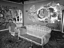 Abandoned building with illicit graffiti vandalism. Abandoned building showing illicit graffiti and vandalism, willful damage throughout Royalty Free Stock Photos