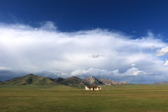 Abandoned building. Infront of the mountains near Son-Kul lake, naryn region, Kyrgyzstan Stock Image