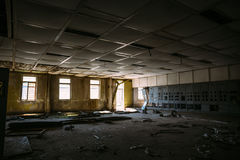 Abandoned building inside interior, large dark room with windows. And light from it Royalty Free Stock Photography