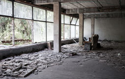Abandoned building interior with bright windows Stock Photography