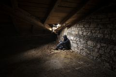 Abandoned building interior. Abandoned and desolate interior of an attic Stock Images