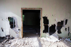 Abandoned building interior. Empty door, holes Stock Image