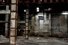 Old warehouse in disrepair, abandoned building interior. Abandoned building interior, old warehouse in disrepair, dangerous industrial zone Royalty Free Stock Photography
