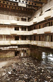 Abandoned building interior in ruins. Warm tone. Vertical format Royalty Free Stock Photography