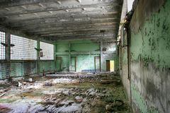 Abandoned Building Interior in school in Prypiat town in Chernobyl Zone. Chornobyl Disaster Stock Photo