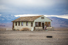 Abandoned Building. A lonely abandoned building crumbles in the nevada desert royalty free stock images