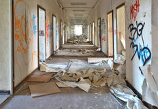 In an abandoned building. Long corridor in an abandoned office building royalty free stock photography