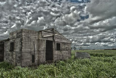 Abandoned building. An old abandoned dairy shed in the middle of a paddock Stock Photos