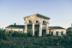 Abandoned building on the outskirts of the city. The dark weather on the outskirts of the city is a lonely abandoned building Royalty Free Stock Photo