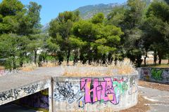 Abandoned building painted graffiti in Loutraki. Royalty Free Stock Photo