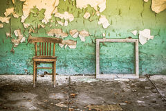 Abandoned building with peeling wall Stock Photo