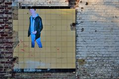 Abandoned building with realistic picture of smoking man Stock Photos