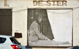 Abandoned building with realistic picture of a Woman. In black and white, streetart in Ghent, Belgium royalty free stock image