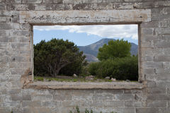 Abandoned building with scenic trees and mountains Royalty Free Stock Photo