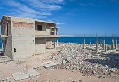 Abandoned building site on coastal beach Royalty Free Stock Photo