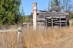 An abandoned building in tall grass. On a sunny day Stock Photo