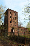 Abandoned building with tower at spring Stock Image