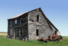 Abandoned building and tractor royalty free stock photos