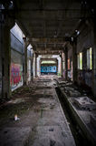 Abandoned building tunnel with graffiti Stock Photos
