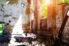 Abandoned building, Ukraine. Abandoned and devastated building in rays of the sun. Ukraine, Donbass. The concept of the fighting force and war royalty free stock photos