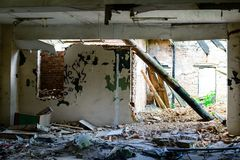 Abandoned building, Ukraine. Abandoned and devastated building in Ukraine, Donbass. Forgotten place. The concept of the fighting force and war royalty free stock images