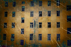 Abandoned building wall with broken glass windows retro photo imitation with hard vignette Stock Images