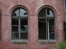 Abandoned building windows. Abandoned building parts, broken windows stock photography