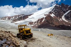Abandoned bulldozer in mountains. Kyrgyzstan Stock Photography