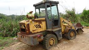An abandoned bulldozer, some areas have rusted royalty free stock photos