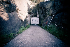 Abandoned bunker. Entrance to abandoned bunker in mountains Stock Photography