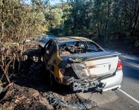 Abandoned burnt out car at the road side rear end image stock image