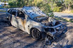 Abandoned burnt out car station wagon front right hand side royalty free stock image