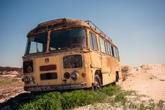 Abandoned bus in the desert stock image