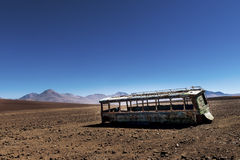 Abandoned bus in the desert in the Potosí Department in Bolivia. Concept for travel in the desert and travel in the Andes Stock Photography