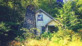 Abandoned cabin. An abandoned cabin in the woods stock images