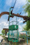 Abandoned cabins of old obsolete aerial cableway are over road in Dnepropetrovsk. Royalty Free Stock Photography