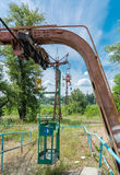 Abandoned cabins of old obsolete aerial cableway are over road in Dnepropetrovsk. Stock Photos