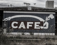 Abandoned Cafe and Phone. Abandoned cafe sign and payphone Stock Images