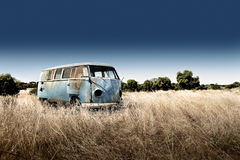 Abandoned Camper. An old abandoned campervan in a field, rusted and broken royalty free stock images