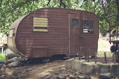 Abandoned Camper. Old camper in scrap yard. Abandoned and weathered with brown rust paint Royalty Free Stock Photo