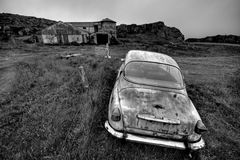 Abandoned car. And farm in black and white, end of the word concept. Location, Iceland Stock Photo
