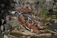 Abandoned Car. A wrecked car at the bottom of a ravine royalty free stock photos