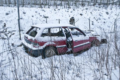 Abandoned car. Sad sight of a car that has been given over to the nature close to the railway line in Halden Royalty Free Stock Photos