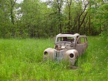 Abandoned Car. Rusty old vehicle in meadow Royalty Free Stock Photography