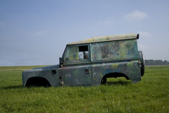 Abandoned Car. Landrover in a meadow stock images
