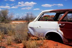 Abandoned car, arid desert, ancient geology Stock Photos